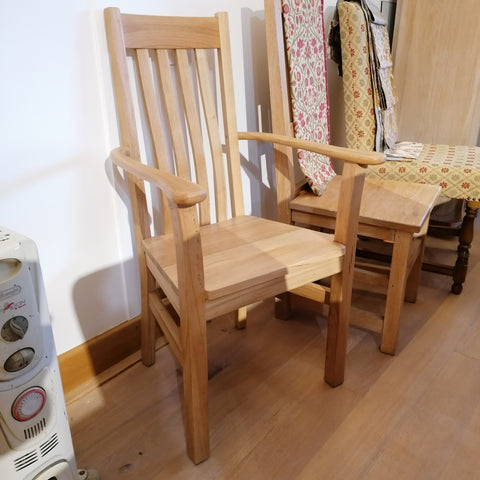 Solid Oak carver chair with wooden seat