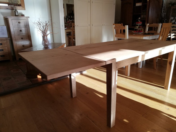 Extended farmhouse dining table