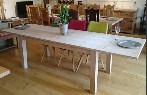 Extended farmhouse dining table showroom