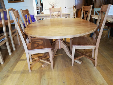 Extending oak pedestal dining table