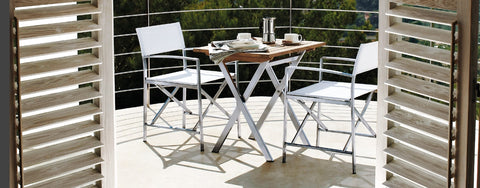 Teak tables with metal base