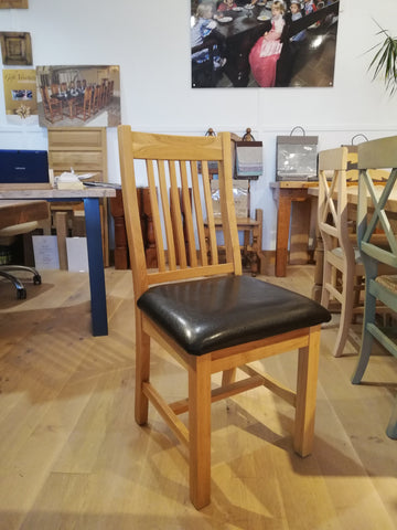 Solid oak low back Lewis side chair with upholstered seat