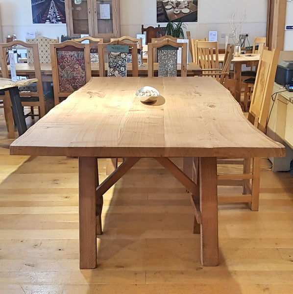 English Oak Trestle Dining Table with Waney Edge Top end view