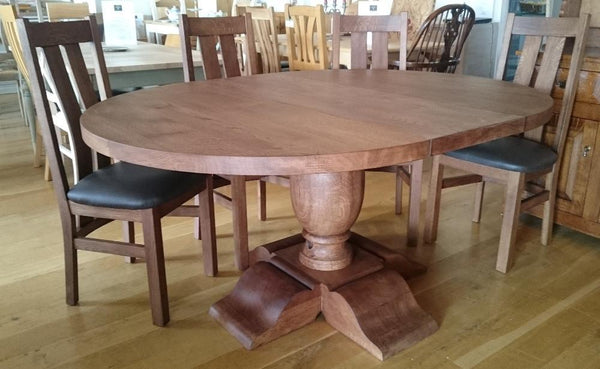 Round oak dining table with extension