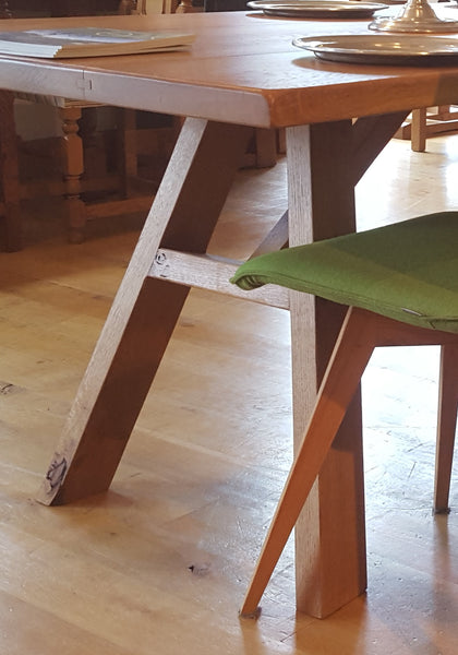 Close up A-frame oak dining table base