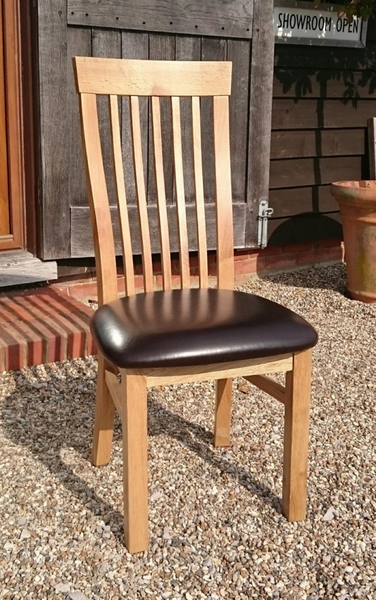 Sedlescombe oak side chair brown seat faux leather