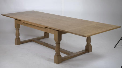Solid oak drawleaf refectory dining table extended