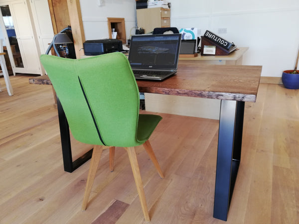 Oak desk top with live edge on a powder coated steel base