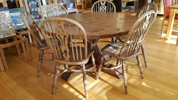 Swailes round oak dining table with braced pedestal and Windsor Chairs