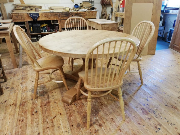 Swailes round oak dining table with braced pedestal in workshop