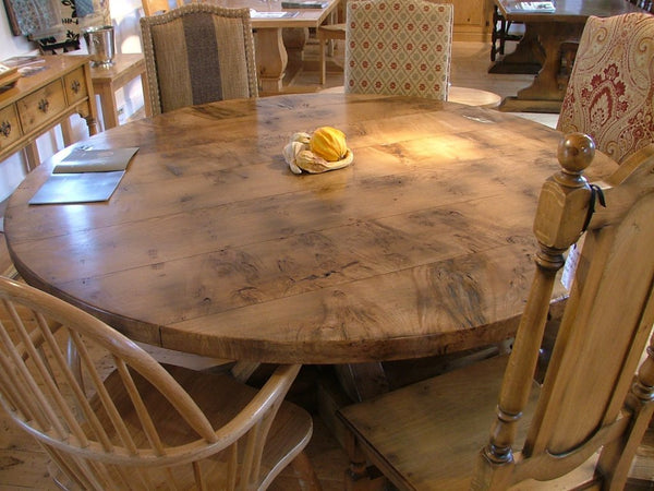 Swailes round oak dining table with braced pedestal with burr oak top