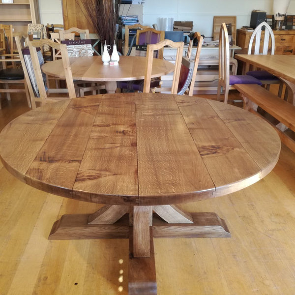 Swailes round oak dining table with braced pedestal top
