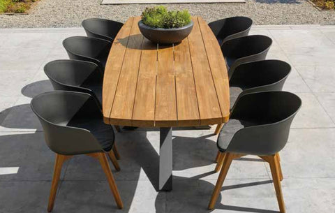 Curved Teak Table on an angled aluminium base