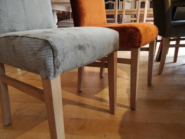 Tillingham fully upholstered oak side chairs close up