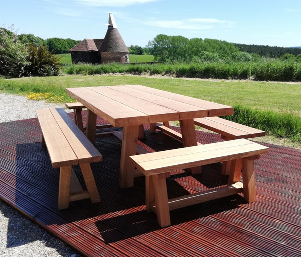 Oak trestle benches with table