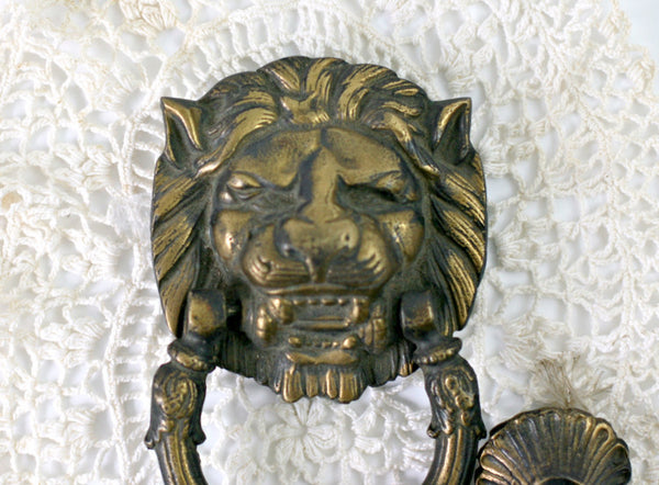 ornate brass lion head door knocker