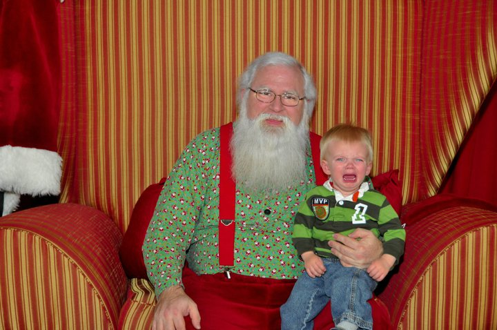 Little Boy Crying On Santa's Lap
