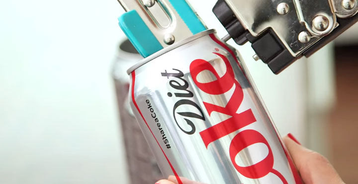 Hole Punch Coke Cans