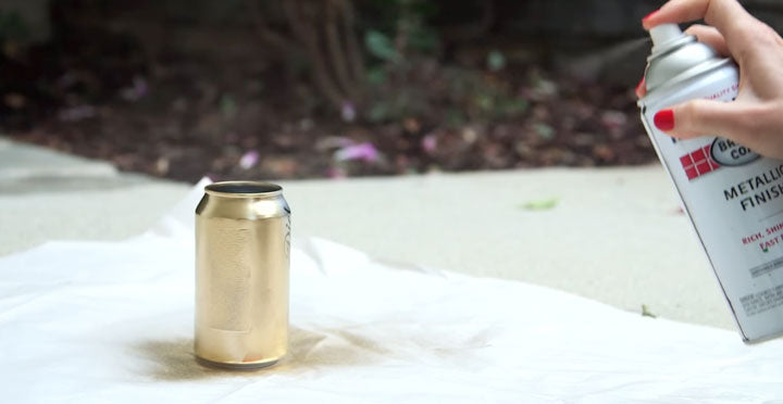 Gold Spray Paint on Coke Cans