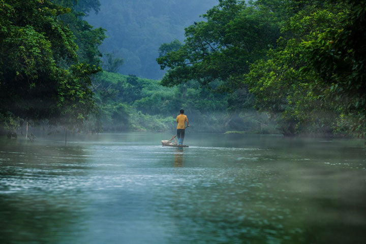 Man on River in Vietnam