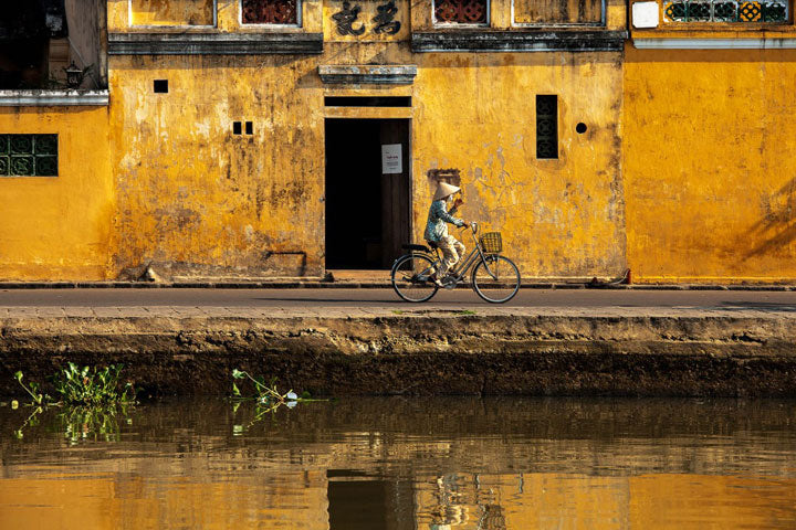 Man Riding Bike In Vietname