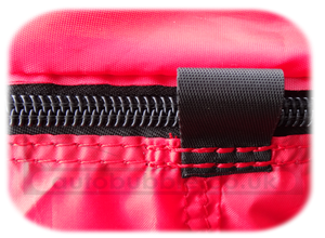 Plastic coated zip with internal protection skirt