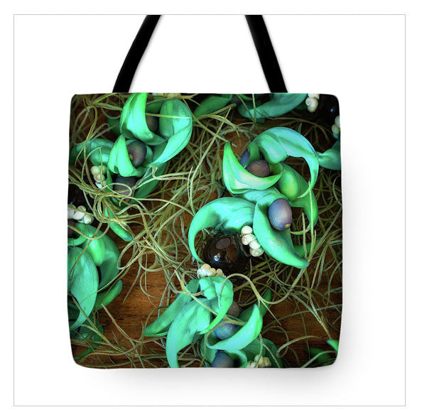 https://jade-moon.pixels.com/products/blue-jade-kukui-and-hinahina-jade-moon-tote-bag.html
