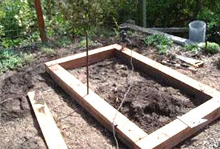 Lumber set out in shape of garden bed