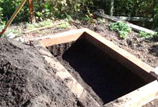 Bed with dug out hole, ready for gopher material