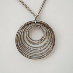 Silvertone Coiled Rings Pendant Necklace Geometric Jewelry