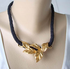 Striking Goldtone Leaf Slider Necklace Heavy Woven Cord Floral Jewelry