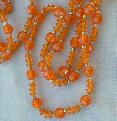 Long 60-inch Amber Orange Colored Bead Necklace Flapper Length Vintage Jewelry