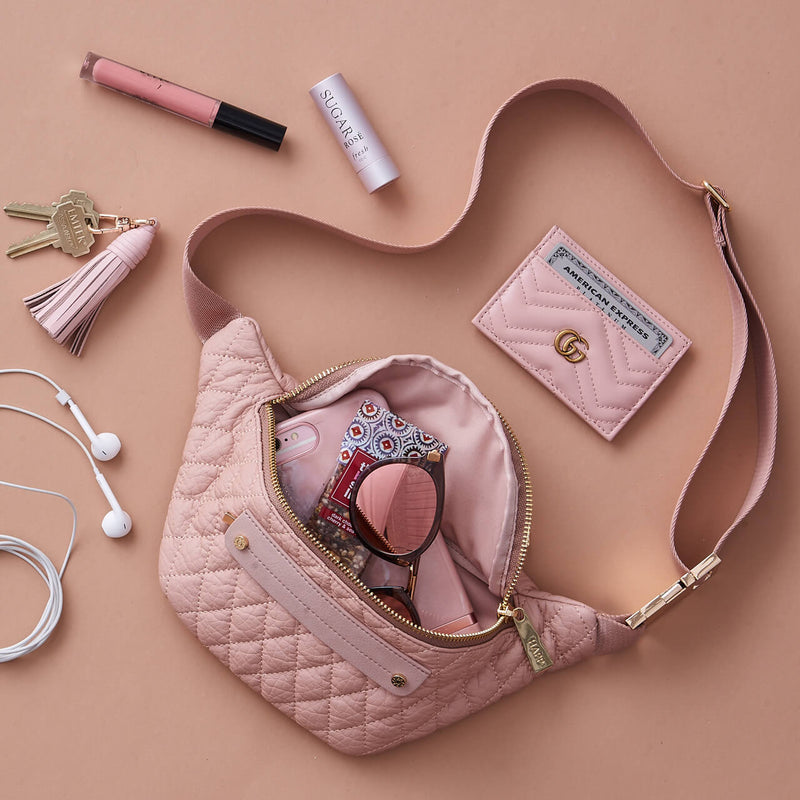 Fefe Fanny Pack diamond quilted faux leather diaper bag accessory in blush pink with gold hardware packing example