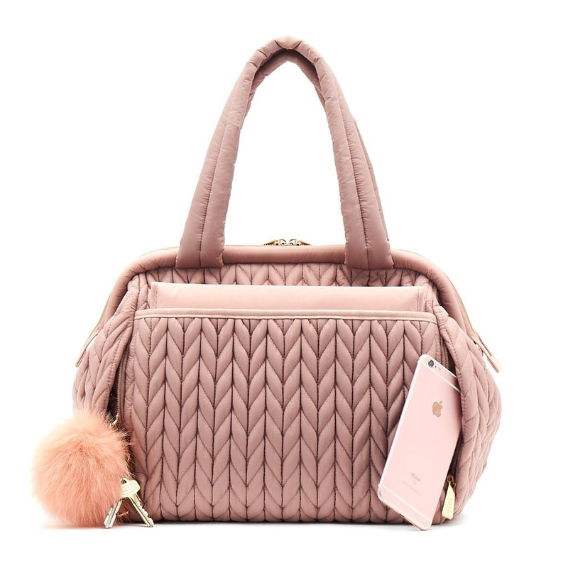 Paige Carryall purse handbag style diaper bag with quilted herringbone nylon in dusty rose blush pink with gold hardware with pink pouf keychain