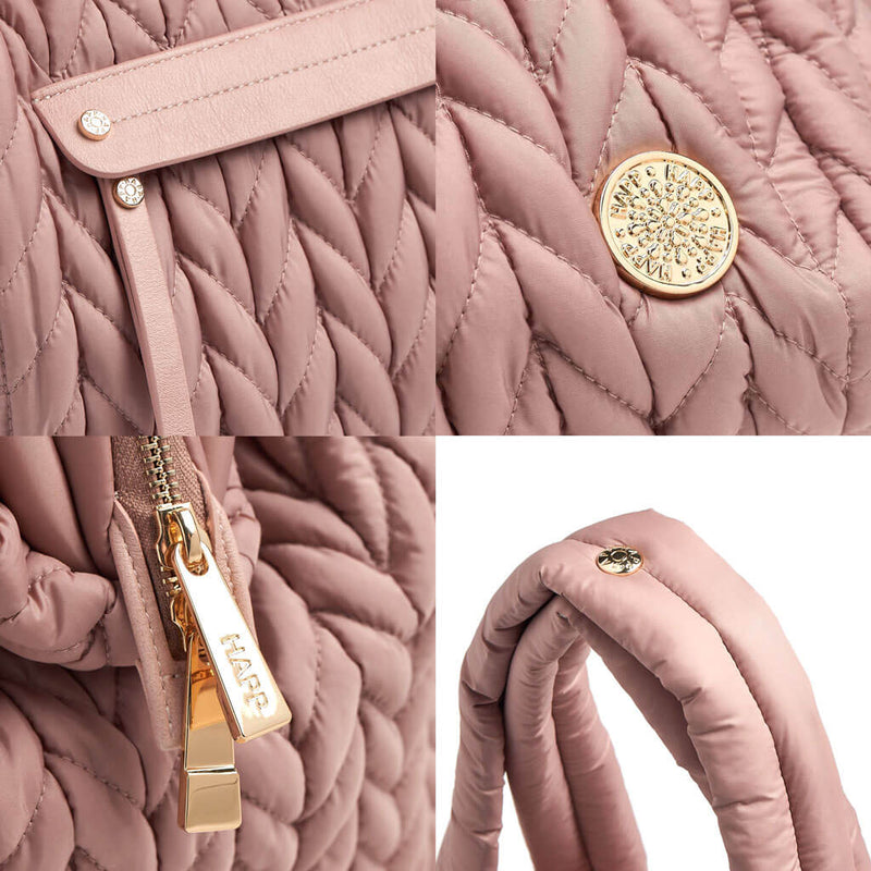 Paige Carryall purse handbag style diaper bag with quilted herringbone nylon in dusty rose blush pink with gold hardware closeup padded strap zipper