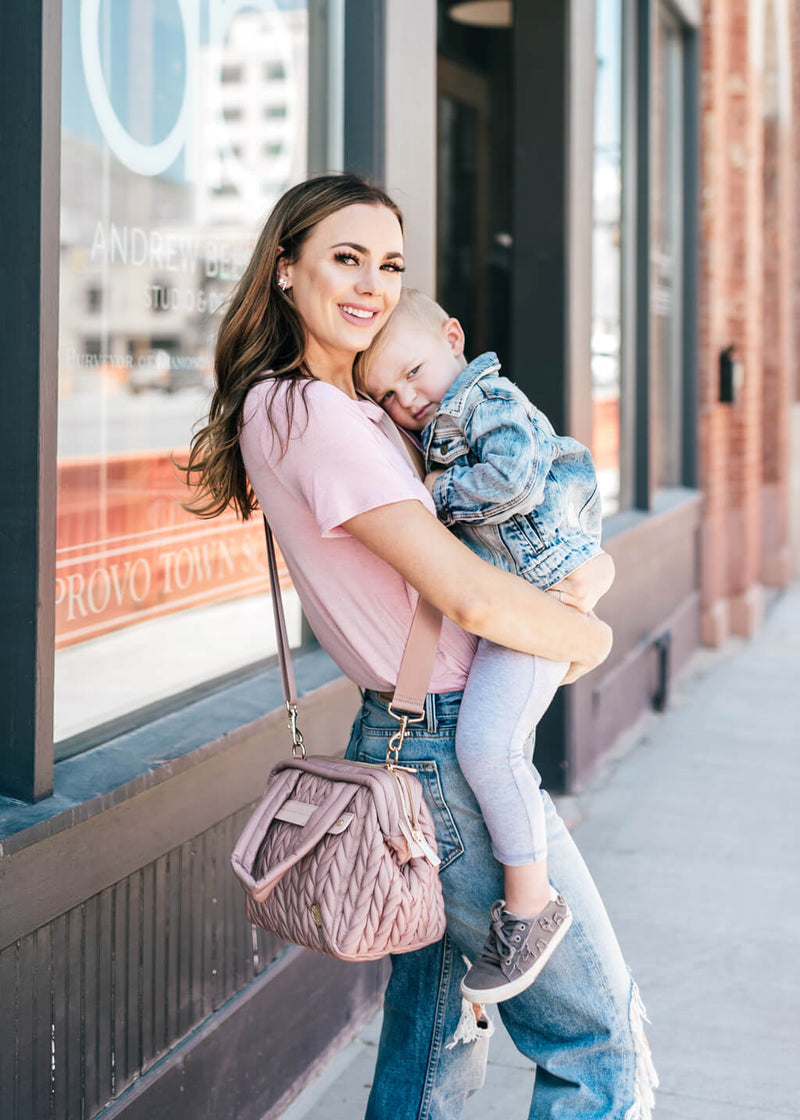 Paige mini purse style diaper bag in dusty rose on body