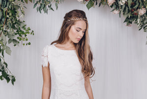Simple pearl and crystal wedding hair vine for a classic boho bride