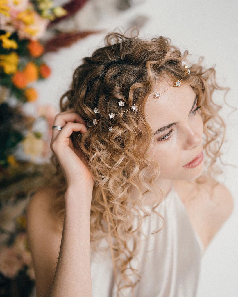 Curly hair bride with star wedding hairpins and forehead band