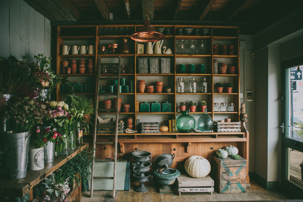 Swallows and Damsons little flower shop with its eclectic mix of terracotta pots and glass and stoneware