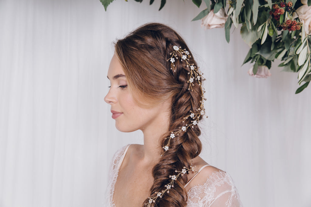 Gold hair vines mixed together to create one bridal plait look