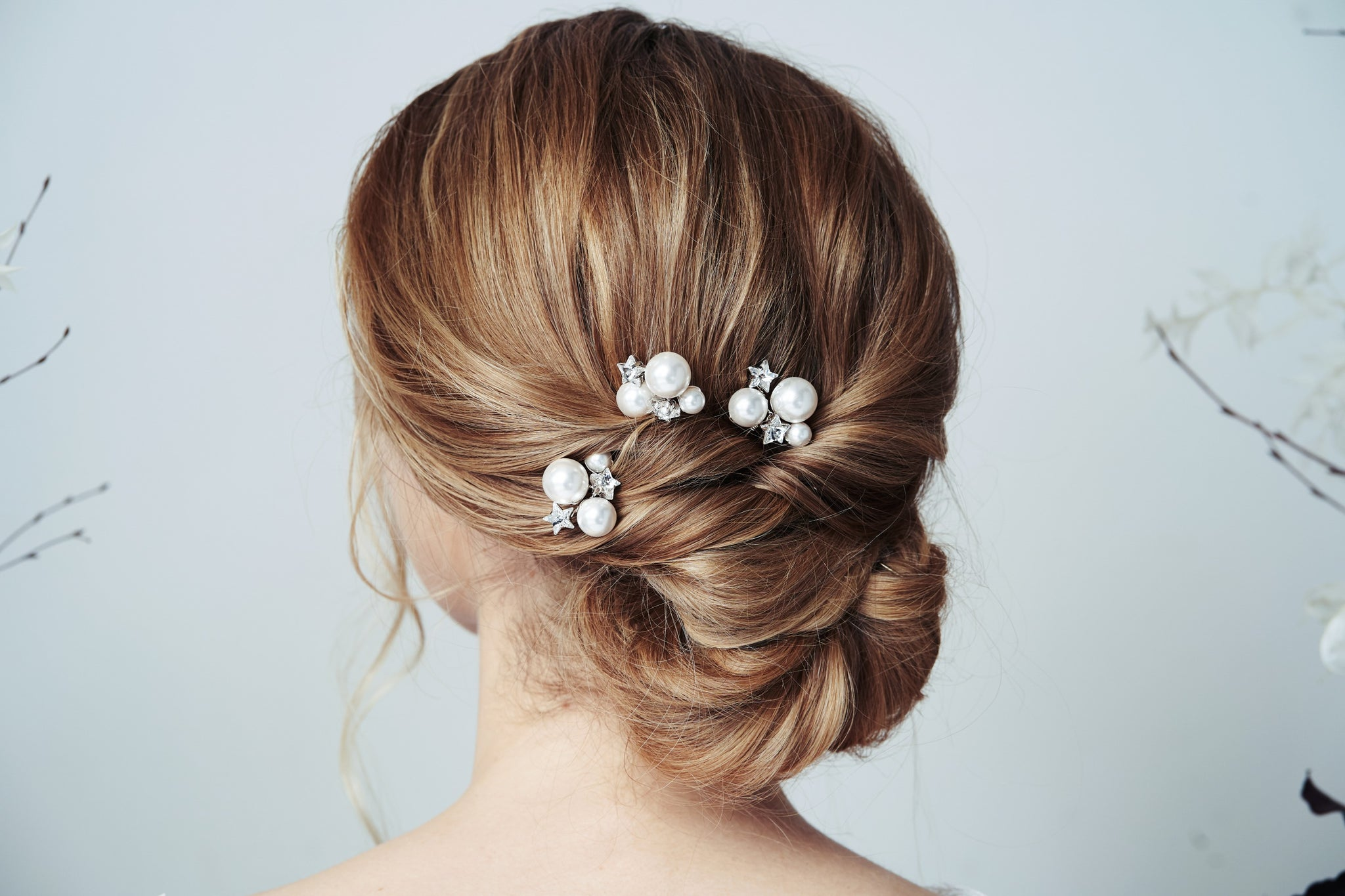 Swarovski star and moon crystal and pearl wedding hairpins trio in the back of an updo Astra