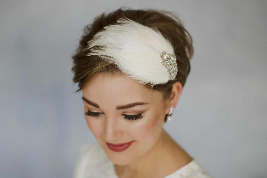 Short haired bride in a feather wedding headband with Swarovski crystals