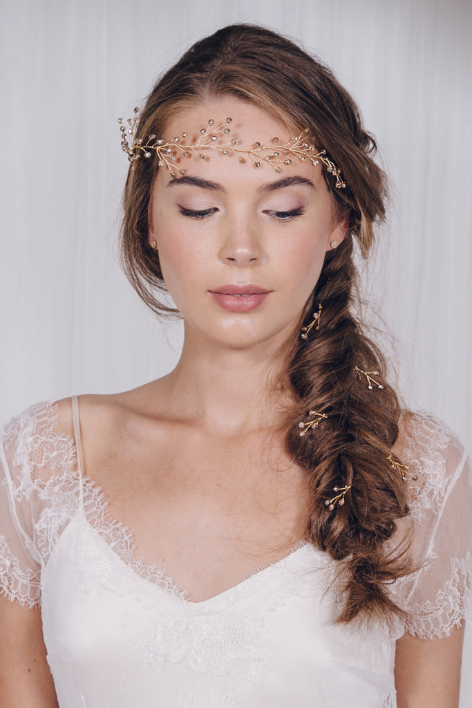 Gold hair pins and hair vine in bridal plait braid