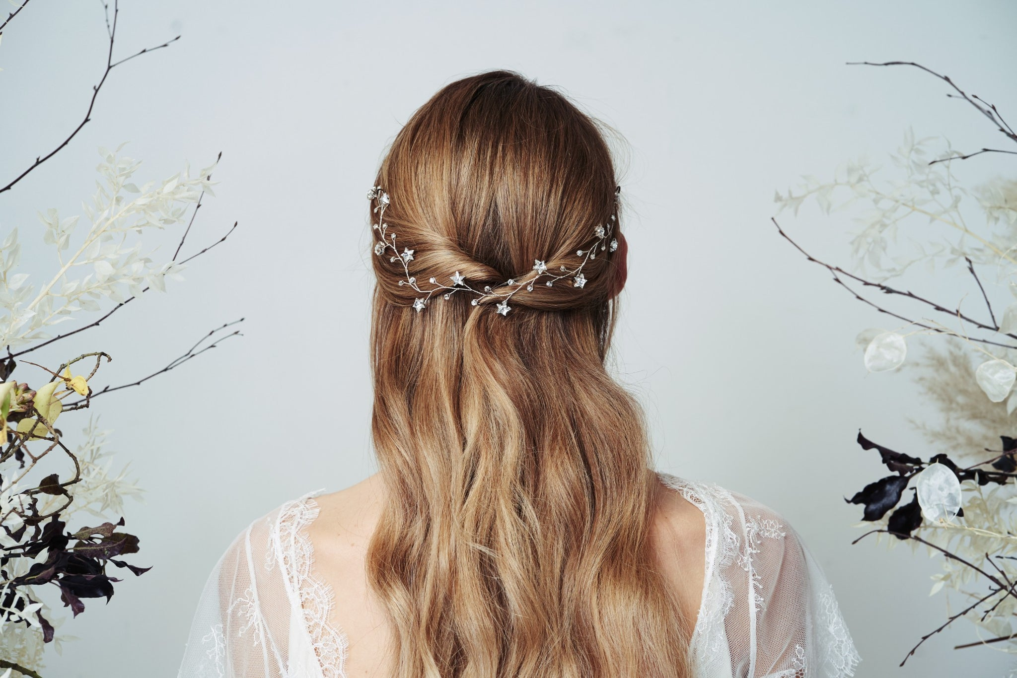Silver star celestial hairvine pinned in the back of a half up hairstyle