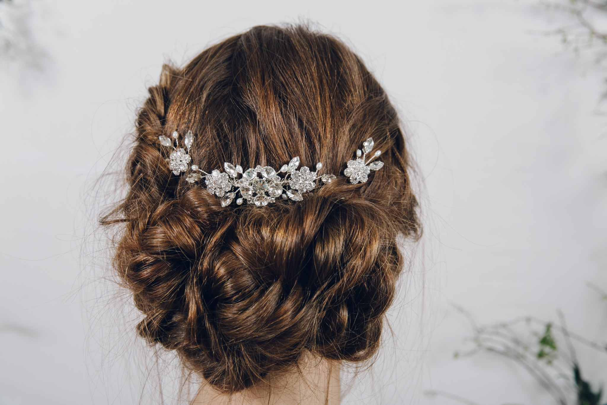 Two Saffron flower wedding hairpins either side of the Lucia floral wedding hair comb
