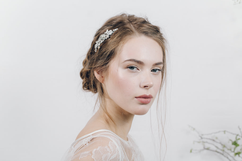 small classic crystal and pearl wedding hair comb with a relaxed bridal braided updo