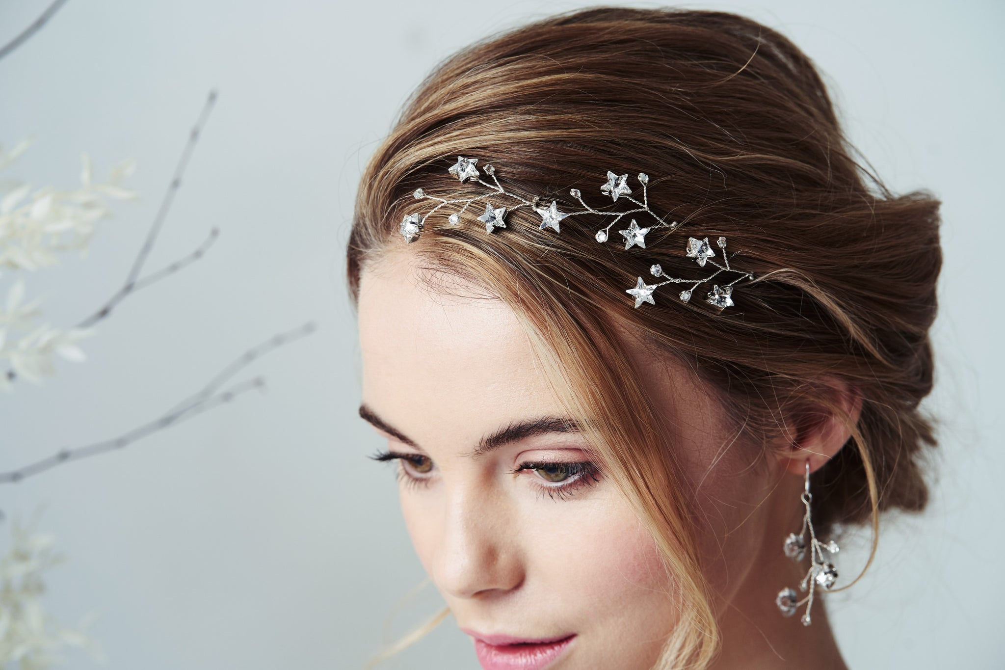 Star constellation Swarovski crystal wedding hairpin trio set in the front of a bridal updo