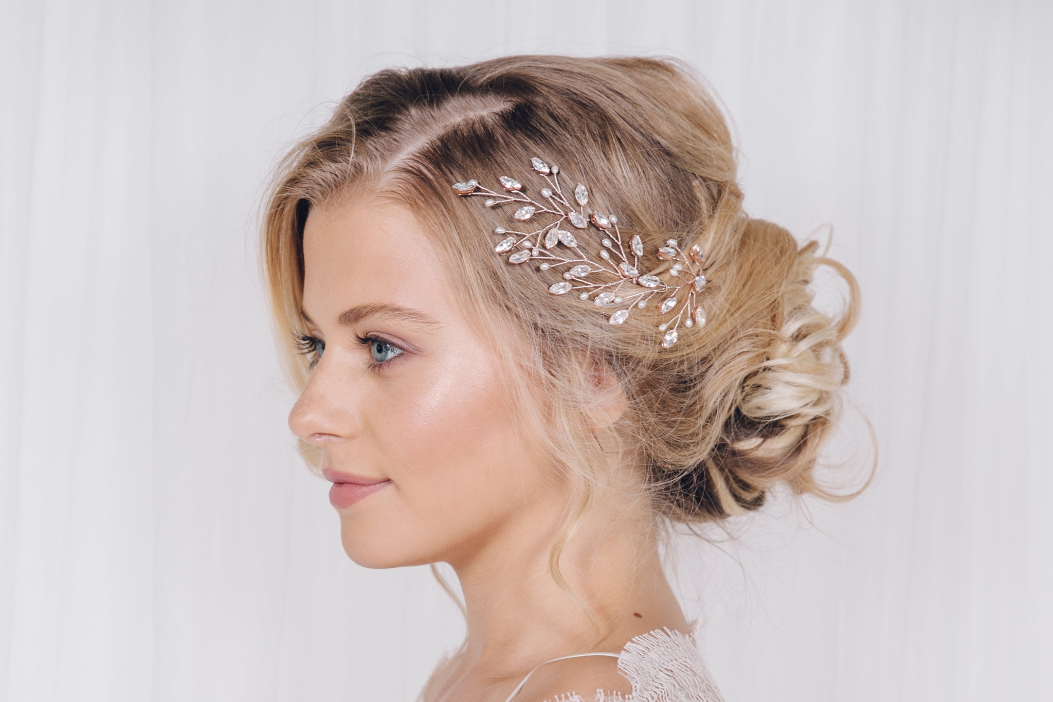 Set of three leafy classic Swarovski crystal and pearl wedding hairpins in a bridal updo