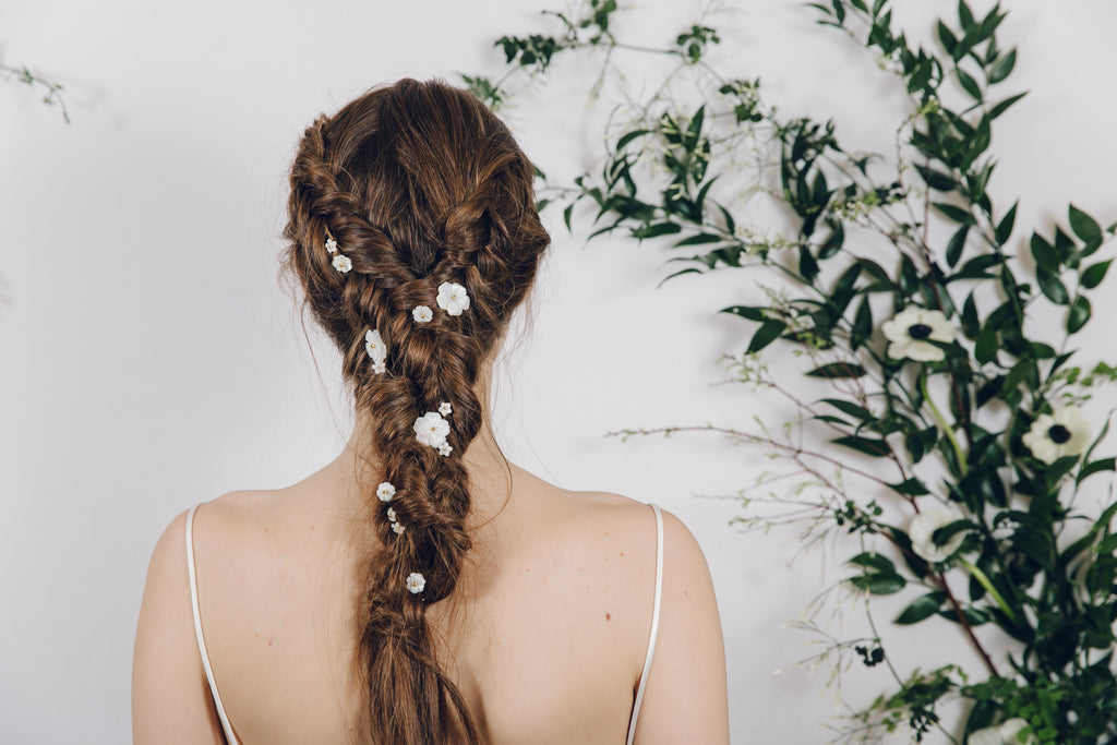 Bohemian braided hair plait with mother of pearl flower hair pins