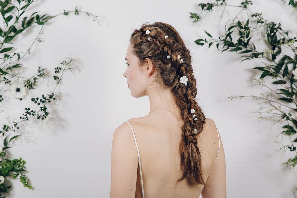 flower hair pins in braided Dutch fishtail plait